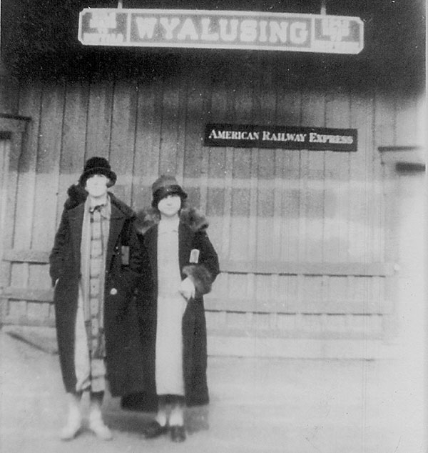 2 women standing outside the Wyalusing, PA train station in the 1920's